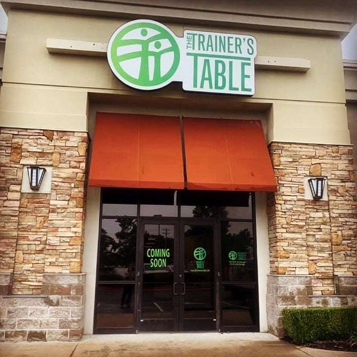 outside view of business displaying bold green logos